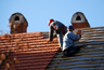 istockphoto_4797370-carpenters-working-on-the-roof.jpg